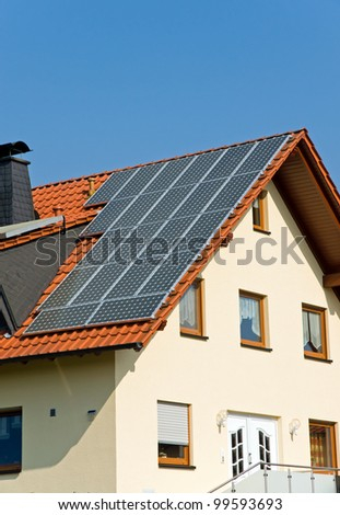 Roof with solar panels in Germany - stock photo