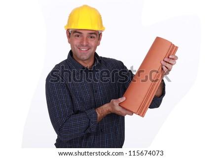 Roofer holding tiles - stock photo