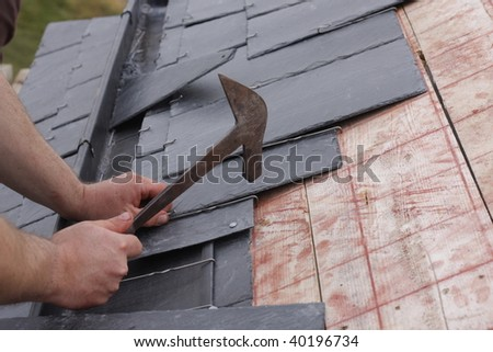 roofer made a roof with slates - stock photo