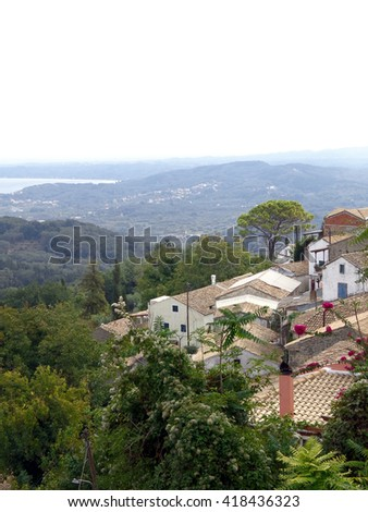 Roofs and mountains - stock photo