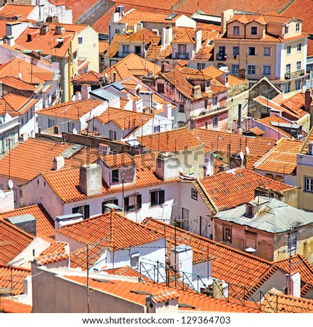 Roofs and white houses view in old Alfama district, Lisbon. Portugal - stock photo