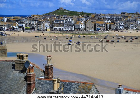 roofs, houses, sea, low tide - stock photo