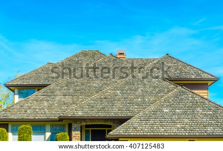 Roofs of a modern house in great neighborhood, in suburbs of Vancouver, Canada. - stock photo