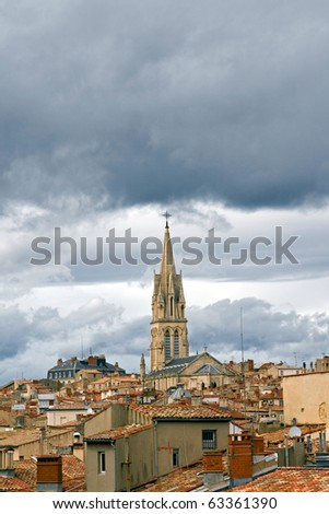 Roofs of Montpellier: vertical shot of roofs of an old section of the city of Montpellier, France, on a cloudy day (clouds are rare in that region). - stock photo