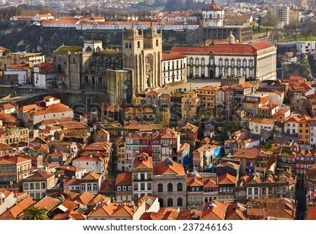 Roofs of old city and The Porto Cathedral (Se do Porto) in Porto, Portugal - stock photo