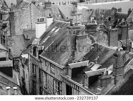 Roofs of the medieval town Blois in Loire valley ( Val de Loire, France) Aged photo. Black and white. - stock photo