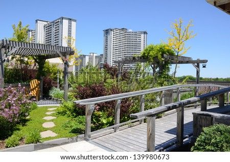Rooftop garden in urban setting - stock photo