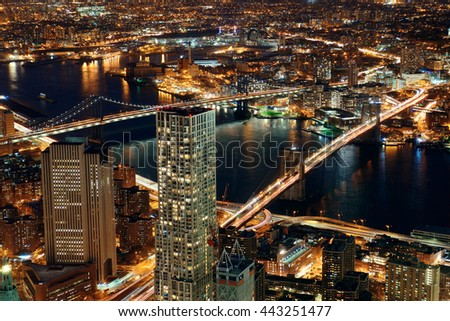 Rooftop night view of New York City downtown with urban skyscrapers - stock photo