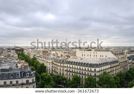 Rooftop Paris Skyline with Madeleine Church and Eiffel Tower, France - stock photo