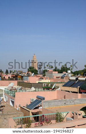 Rooftops in Marrakesh, Morocco with blue sky and solar panels. - stock photo