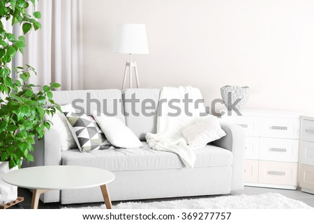 Room interior with sofa, commode and table - stock photo