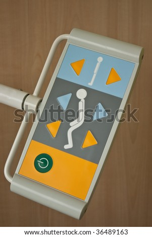 Room with bed in hospital bed remoot control - stock photo