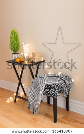 Room with Christmas decorations and little green tree. - stock photo