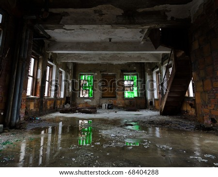 room with green windows lies in decay - stock photo