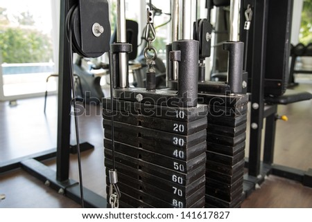 Room with gym equipment in the sport club - stock photo