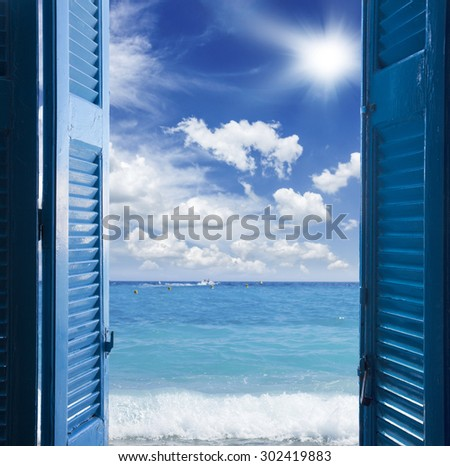 room with open blue door  to seascape - vacation  concept - stock photo