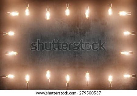 room with pendant lamps around and blackboard background - stock photo