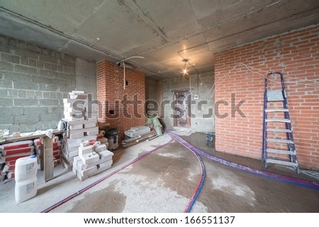 Room with universal gypsum plaster and others building materials in a newly built house - stock photo