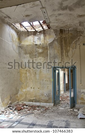 rooms and roofs destroyed house broken - stock photo