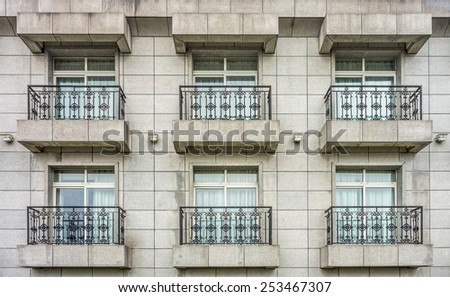 Rooms with balconies of building - stock photo