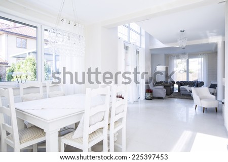 Roomy interior of dinning room and living room - stock photo