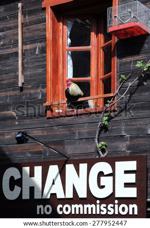 Rooster in the window above the currency exchange office in Bulgaria - stock photo