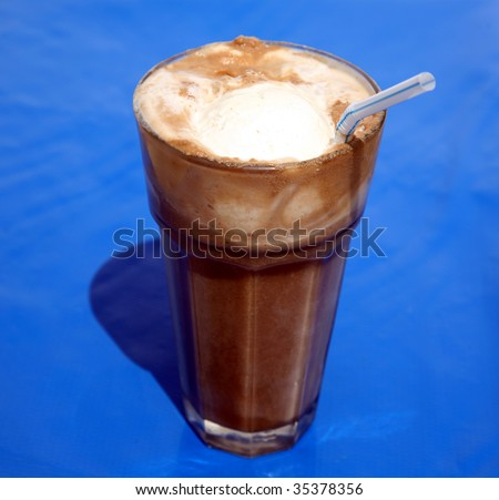 root beer float, on blue - stock photo