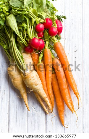 root vegetables on wooden table - stock photo