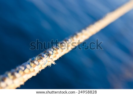 rope against blue sea - stock photo