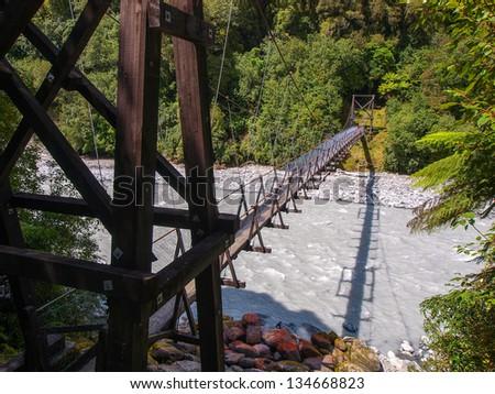 Rope bridge New Zealand Fox Glacier Region - stock photo