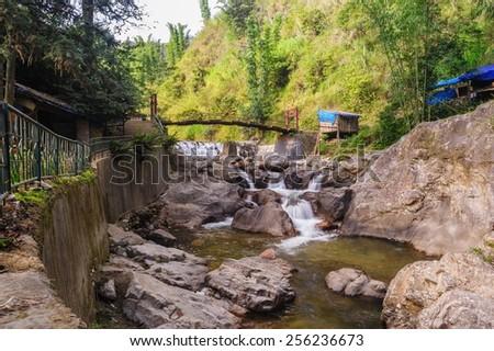 Rope bridge over Tien Sa water fall in Cat Cat village Sapa,Vietnam. - stock photo