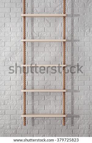 Rope Ladder in front of Brick Wall extreme closeup - stock photo