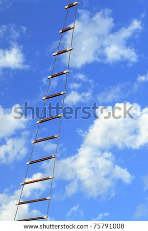 Rope ladder on the sky background - stock photo