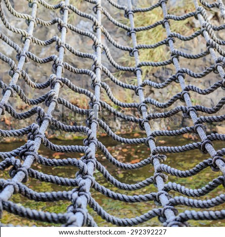 rope net tied for climb in close up nature background - stock photo