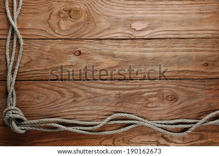 rope on the background of wooden boards - stock photo