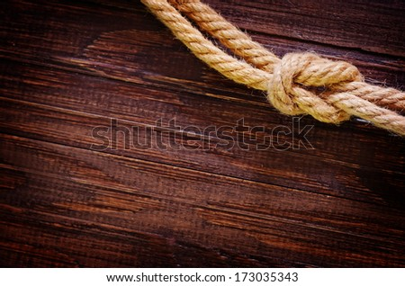 rope on wooden background - stock photo