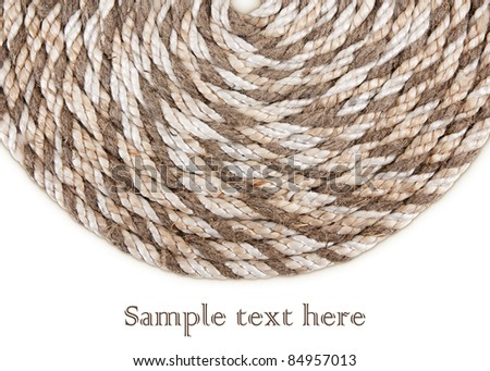 rope twisted in a circle isolated on a white background - stock photo