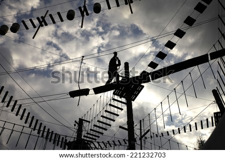 ropes course. safety line on a survival tour - stock photo