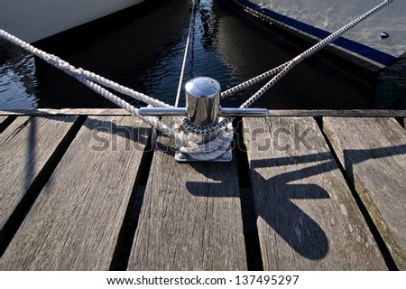 Ropes on a dock - stock photo