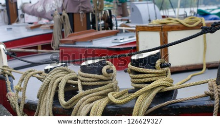 ropes on boat deck for fixing on a quay - stock photo