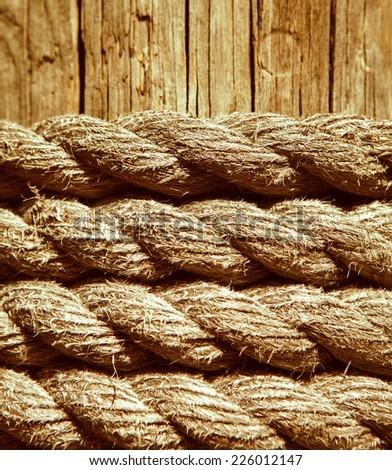 ropes on wood background - stock photo