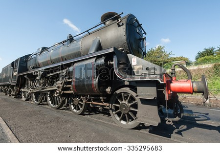 ROPLEY, UK - 19 SEPTEMBER: Vintage steam locomotive LMS Black 5 - 45379 at the Mid-Hants Watercress railway station of Ropley, UK on 19 Septermber, 2015 - stock photo