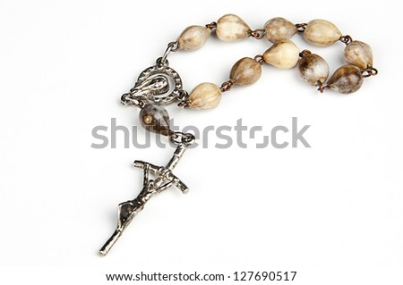 rosary with pope`s cross done with seeds of coix lacryma - Jobi (Job`s tears) - traditional rosary beads - stock photo