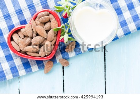Rose, Almond milk with almond seed, almond  organic healthy nut vegan vegetarian drink wood teak background rustic still life, valentines day - stock photo