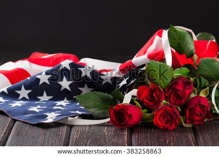 Rose and american flag on wood background - stock photo