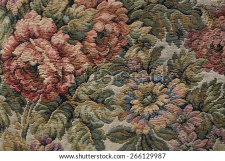 rose embroided on a fabric - stock photo
