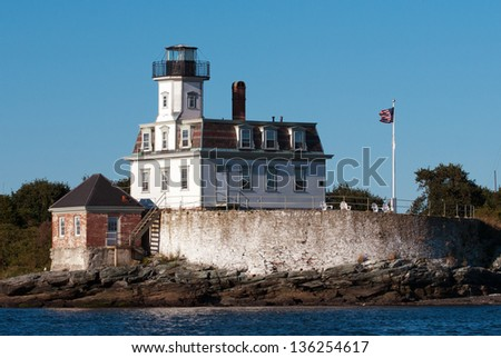 Rose Island Lighthouse is open daily during the summer months, and guests can also stay at the lighthouse. - stock photo