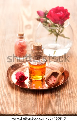 Rose oil and sea salt. Spa, body care and aromatherapy - stock photo