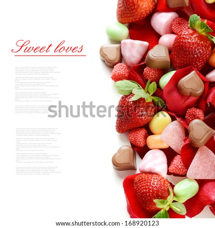 rose petals,chocolate, strawberry and candy on a white background - stock photo