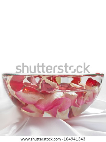 rose petals in bowl with water - stock photo